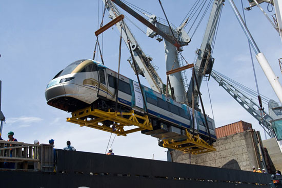 A Gautrain railcar built and shipped from the UK is being unloaded in Durban. From there it made its way to Midrand for quality and safety checks. There is a specially built track for test runs there