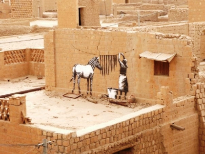 A wall in Timbuktu, Mali with what appears to be Banksy's artwork, January 2009 (Courtesy of the Scenic Sidewalk, a catalog of international street art)