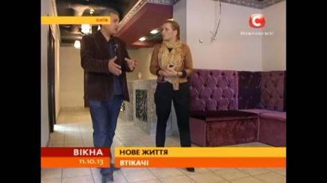 Irina Zayets, Ukrainian STB TV journalist talks to Hussam for an evening news report.