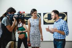 Ekaterina Doroshevskaya, contributing editor at Dnipropetrovsk-based TV channel 34, interviews Pavlo Gudimov during the launch of The Pulse of Africa, his curatorial attempt at 'dialogue with Africa.'