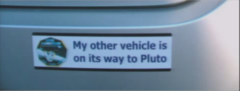 Astrodynamics meets a bumper sticker. This one says: My other vehicle is on its way to Pluto