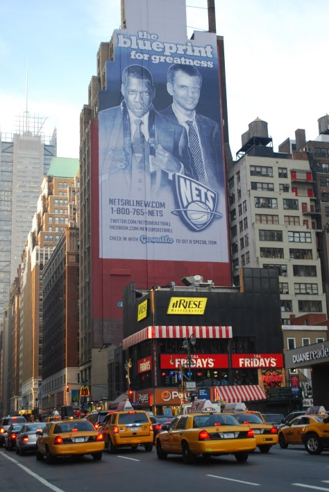 A billboard over NYC. Mikhail Prokhorov with former Brooklyn Nets co-owner and rapper Jay Z. If you care, google up these two's cameo with Michael Bloomberg (Photo: Ihatelupica.blogspot.com)